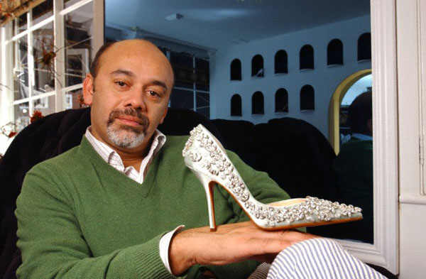 17 Mar 2005 --- Christian Louboutin, shoe designer. Photographed at his shop in Motcomb Street, London SW1, UK. Holding 'Let's Go Crystal' shoe. March 17, 2005. Photo copyright: Eleanor Bentall 17th March 2005. Photo: Eleanor Bentall --- Image by © Eleanor Bentall/Corbis