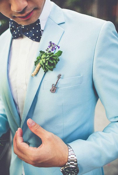 groom-in-agua-limpet-shell-blue-tux-404x600