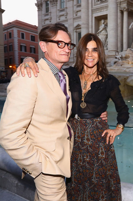 ROME, ITALY - JULY 07: Hamish Bowles and Carine Roitfeld attend the Fendi Roma 90 Years Anniversary fashion show at Fontana di Trevi on July 7, 2016 in Rome, Italy. (Photo by Vittorio Zunino Celotto/Getty Images for FENDI)