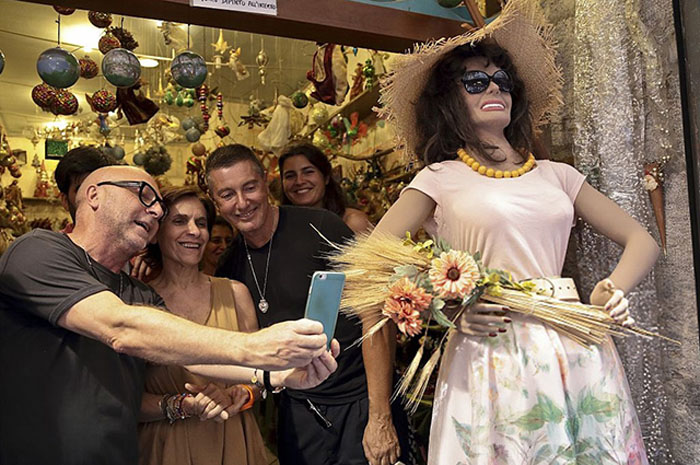 NAPLES, ITALY - JULY 7: Italian stylists Domenico Dolce and Stefano Gabbana visit San Gregorio Armeno street, famous all around the world for the nativity shops, during the first day of the party organized to celebrate the thirtieth birthday of the fashion house in Naples, Italy on July 7, 2016. (Photo by Stringer/Anadolu Agency/Getty Images)